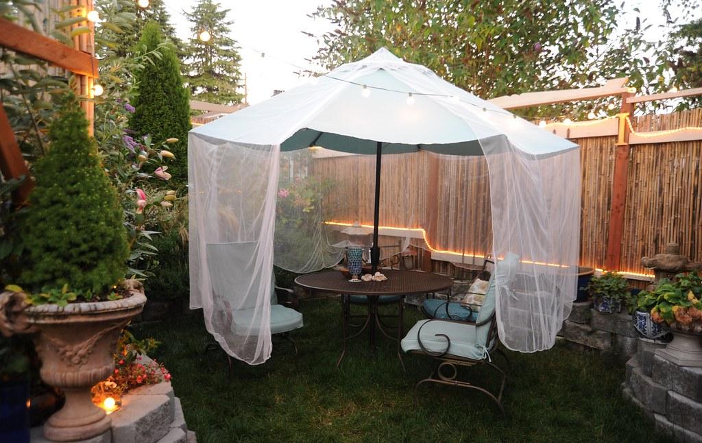 anti mosquito net on patio furniture in amazing backyard