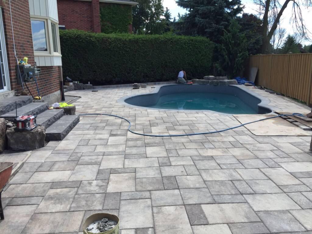 Amazing Backyard Interlocking Around a Swimming Pool - Interlocking Services Aurora